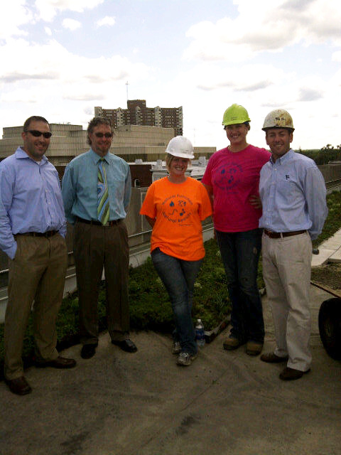 The LiveRoof installation and design team enjoys a job well done at the Kalamazoo City Hall green roof installation site.