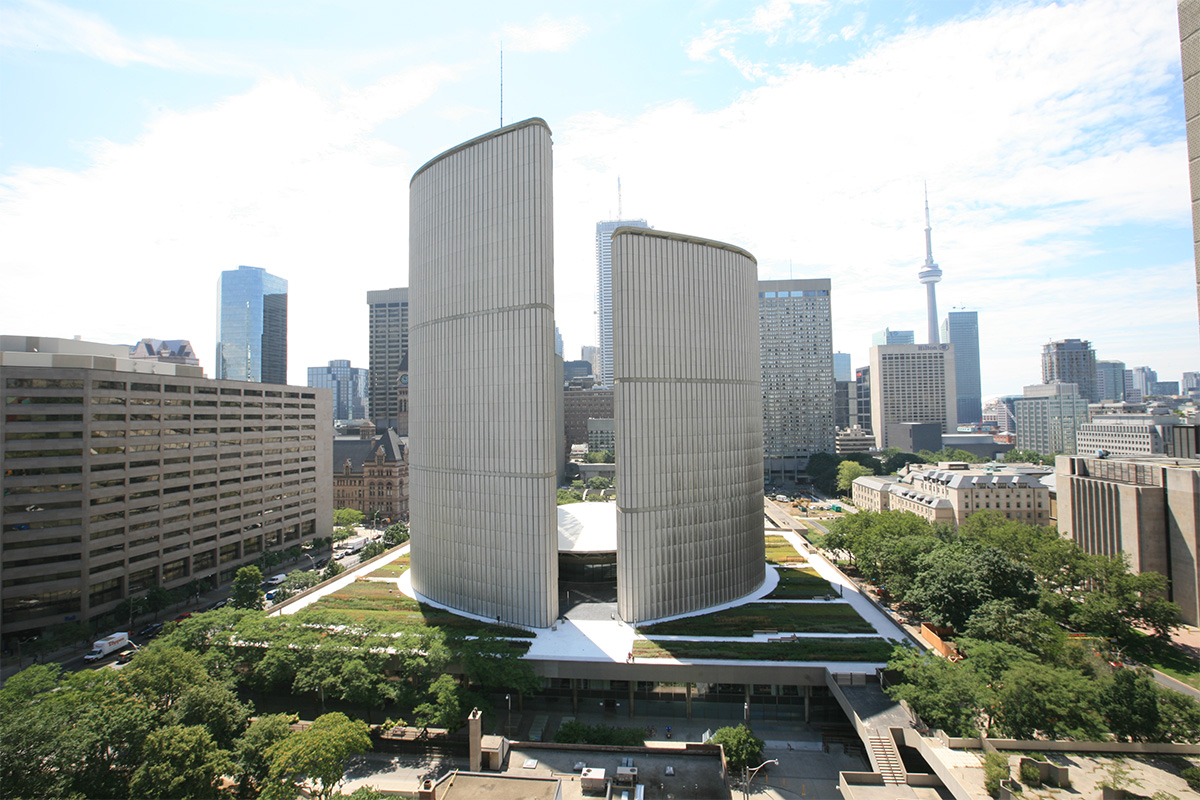 Building with green roofs surrounding in the city of Toronto.
