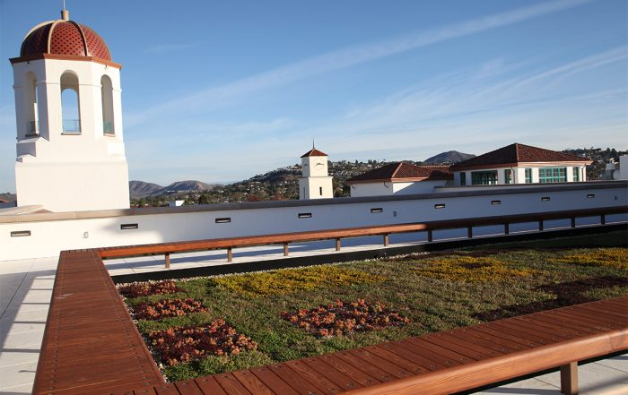 Green living roof surrounded by bench seating on a rooftop in San Diego, California.