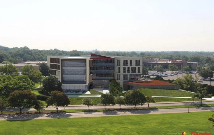 A view of the exterior of the Kansas University School of Business on a sunny day.